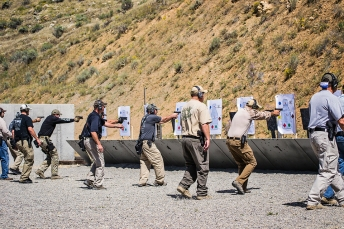 Attendees participate in a drill on Action Target's Line of Fire range equipment during Law Enforcement Training Camp 2014
