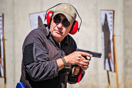 Firearms instructor Brian Hoffner demonstrates using a pistol and knife in tandem at Action Target's 2014 Law Enforcement Training Camp