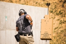 A trainee practices a charging drill with the PT Runner at Action Target's 2014 Law Enforcement Training Camp