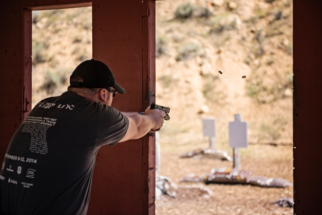 A trainee fires at a reactive steel bobber target at Action Target's 2014 Law Enforcement Training Camp